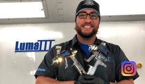 Danny holding two sata spray paint guns with lumaiii LED spray paint gun attachments.