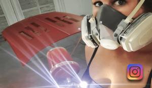 Linda Meck holding her Luma III LED spray gun attachment.