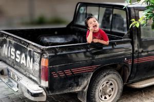 child in pickup